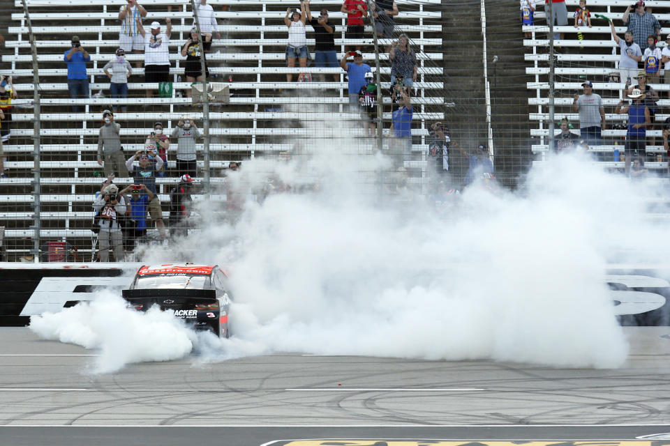 Austin Dillon does a burn out on the front stretch after winning the NASCAR Cup Series auto race at Texas Motor Speedway in Fort Worth, Texas, Sunday, July 19, 2020. (AP Photo/Ray Carlin)