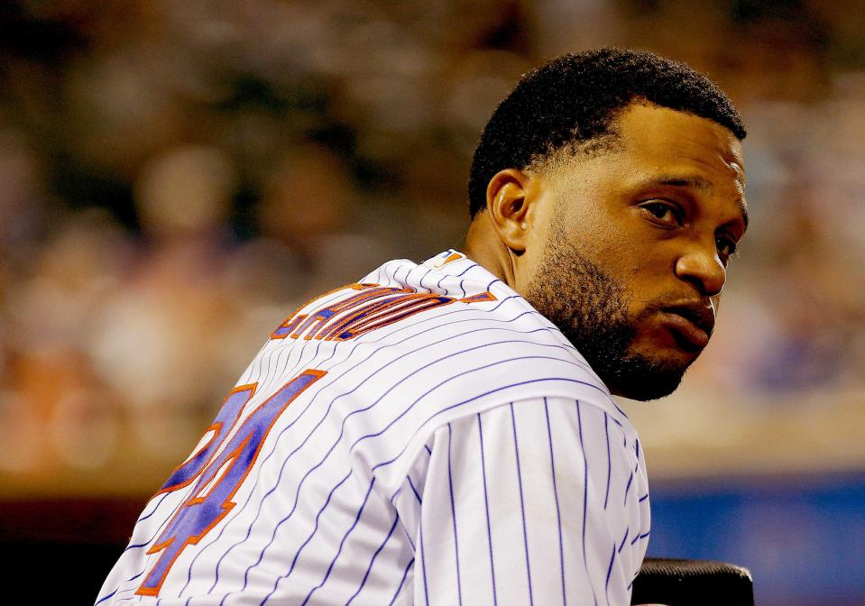 Jun 28, 2019; New York City, NY, USA; New York Mets second baseman Robinson Cano (24) looks on from the dugout against the Atlanta Braves during the  inning at Citi Field. Mandatory Credit: Andy Marlin-USA TODAY Sports