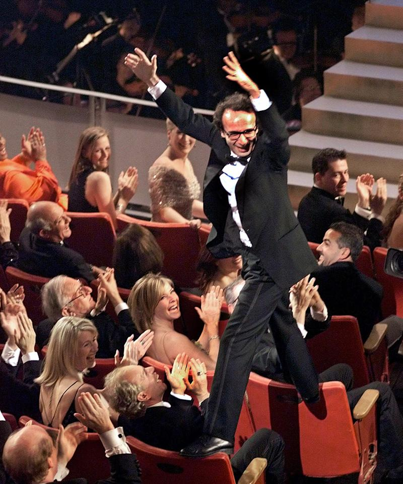 """Roberto Benigni's seat climbing (1999): Speaking of acrobatics, there's Benigni. Ever the clown, the Italian actor and director couldn't just walk up on stage and give humble, teary-eyed thanks when his """"Life Is Beautiful"""" won the Oscar for best foreign-language film. Instead, he leaped from one seat back to another, whipping the audience into a frenzy, before hopping up the steps and giving presenter Sophia Loren a long, tight bear hug. (""""Life Is Beautiful"""" also earned a best-actor Oscar for Benigni and one for its original score.)"""