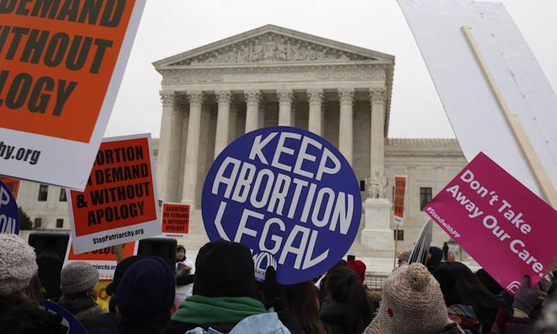 Protesters march in front of the supreme court during the March for Life 2016 in Washington, DC.