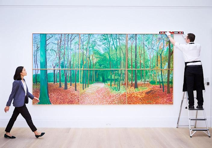 <p>A monumental masterpiece, 'Woldgate Woods, 24, 25 and 26, 2016, by the British Artist David Hockney is unveiled at Sotheby's on Sept. 30, 2016 in London, England. Estimated at $9-12m, the painting is set to break the auction record for Hockney when offered at Sotheby's New York on Nov. 17, 2016. (Photo: Michael Bowles/Getty Images/Sotheby's)</p>