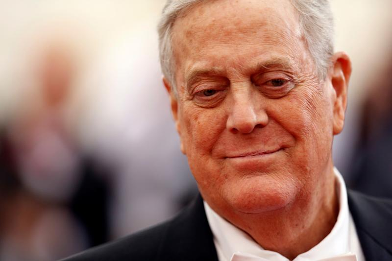 Businessman David Koch arrives at the Metropolitan Museum of Art Costume Institute Gala Benefit in New York on May 5, 2014. | Carlo Allegri—Reuters
