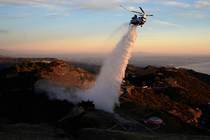 <p>A Chinook CH-47 helitanker makes a water drop in the Santa Monica Mountains west of Los Angeles</p> ((Associated Press))