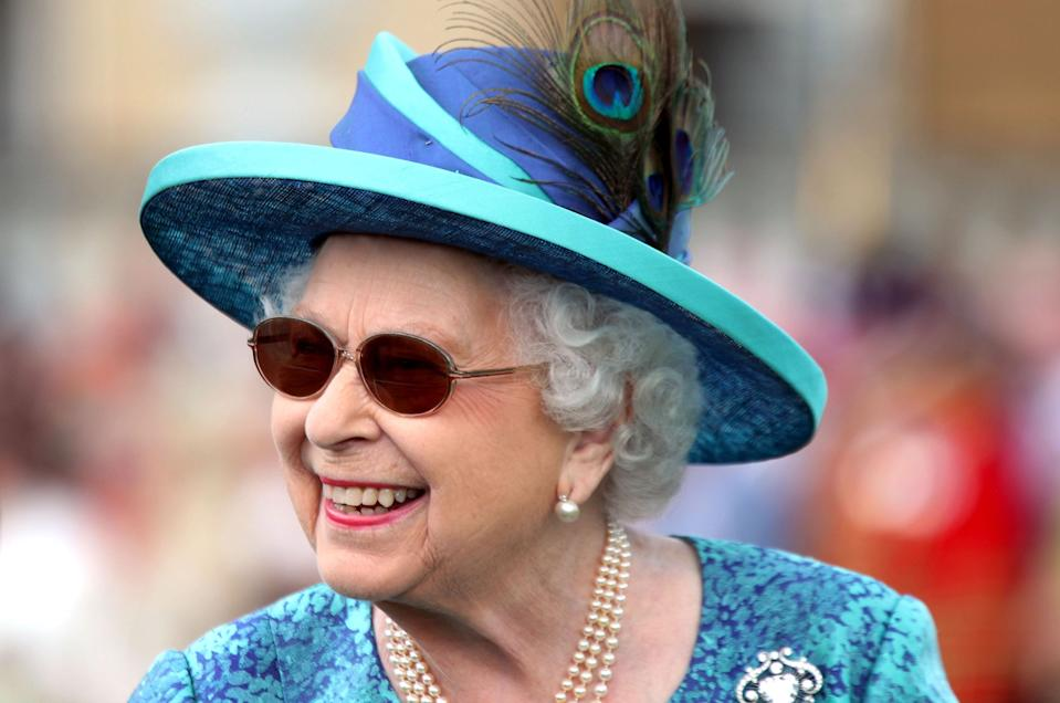 Britain's Queen Elizabeth II arrives for a garden party at Buckingham Palace in London on May 31, 2018. (Photo by Yui Mok / POOL / AFP) (Photo by YUI MOK/POOL/AFP via Getty Images)