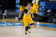 Michigan forward Austin Davis celebrates after scoring during the second half of a Sweet 16 game against Florida State in the NCAA men's college basketball tournament at Bankers Life Fieldhouse, Sunday, March 28, 2021, in Indianapolis. (AP Photo/Jeff Roberson)