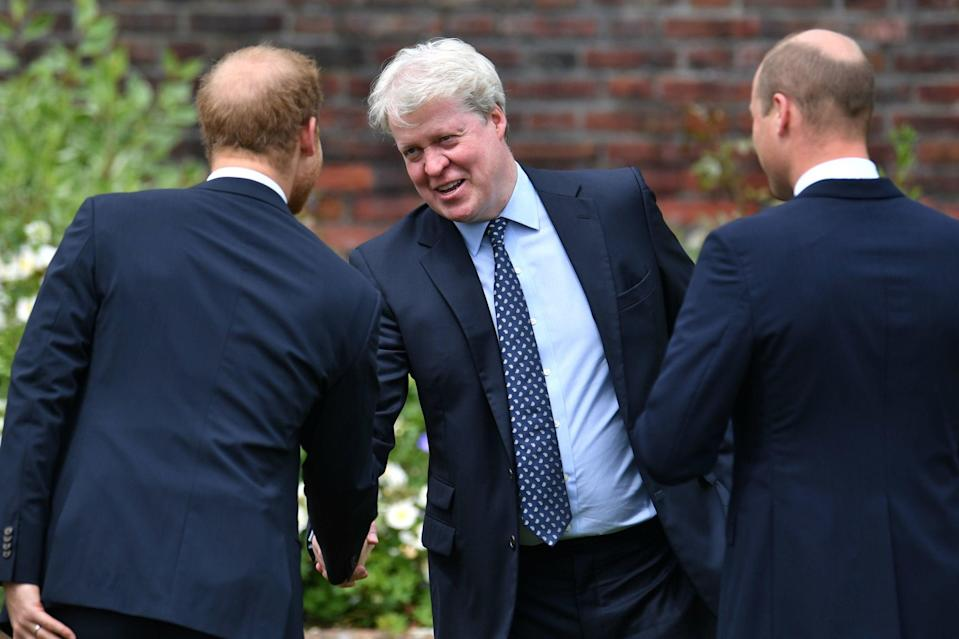 Earl Spencer is greeted by his nephews (PA)