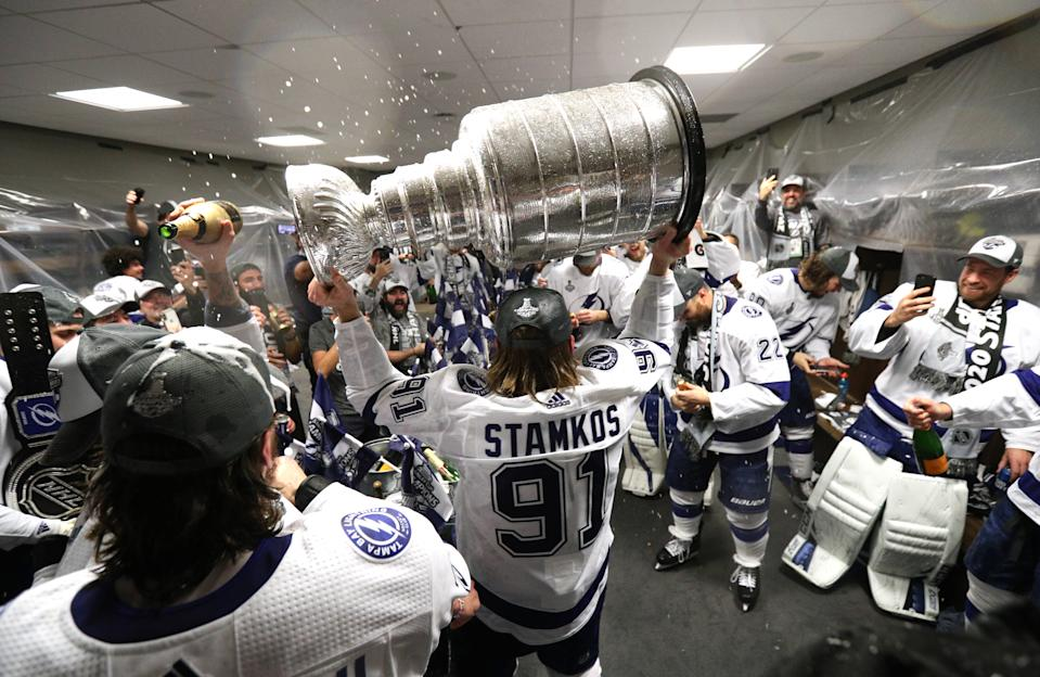 EDMONTON, ALBERTA - SEPTEMBER 28: Steven Stamkos #91 of the Tampa Bay Lightning hoists the Stanley Cup overhead in the locker room after the Tampa Bay Lightning defeated the Dallas Stars 2-0 in Game Six of the NHL Stanley Cup Final to win the best of seven game series 4-2 at Rogers Place on September 28, 2020 in Edmonton, Alberta, Canada. (Photo by Dave Sandford/NHLI via Getty Images)