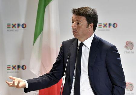 Italian PM Renzi gestures during the news conference at the Expo 2015 global fair in Milan