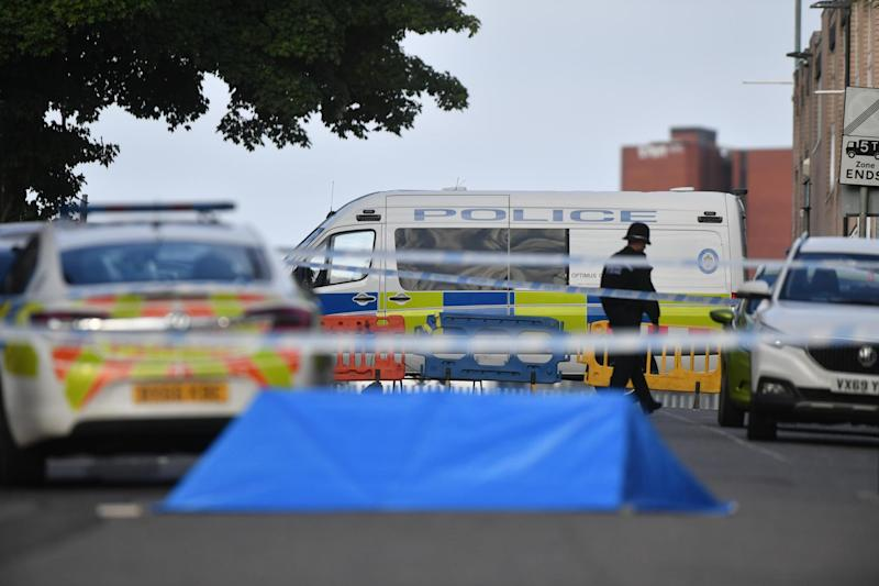 A police officer and vehicles at a cordon in Irving Street in Birmingham after a number of people were stabbed in the city (PA Wire/PA Images)