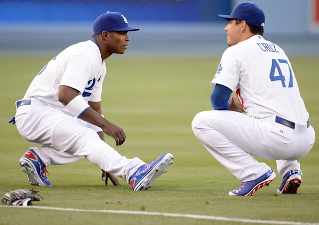 LOS ANGELES, CA - JUNE 03: Yasiel Puig #66 of the Los Angeles Dodgers stretches with Luis Cruz #47 before his major league debut against the San Diego Padres at Dodger Stadium on June 3, 2013 in Los Angeles, California. (Photo by Harry How/Getty Images)
