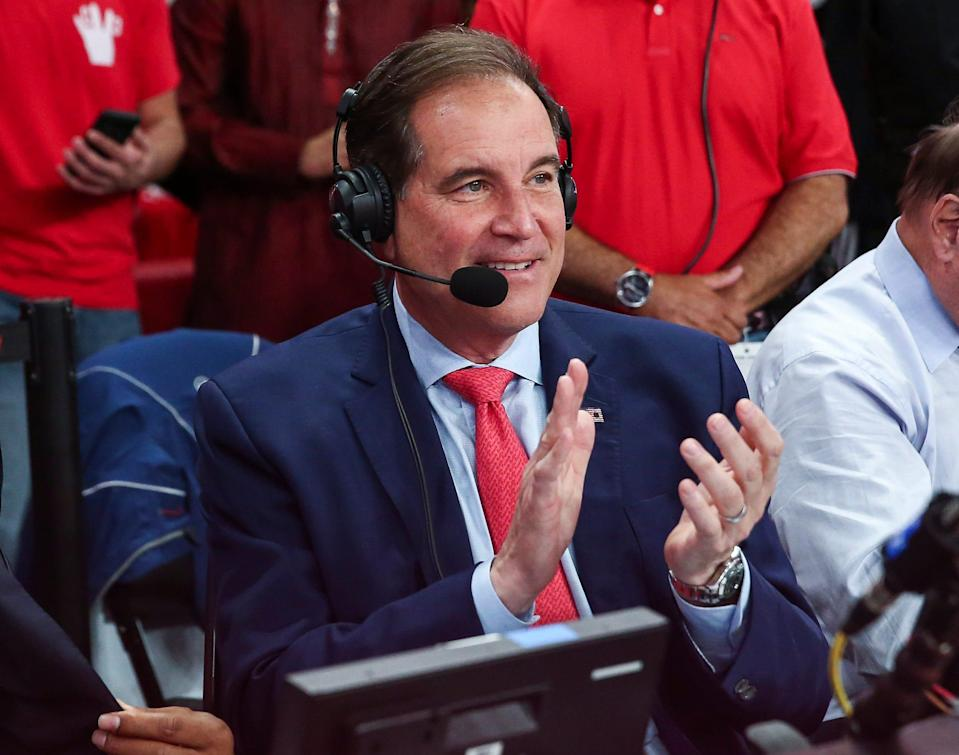 Broadcaster Jim Nantz applauds after a basketball game between the Houston Cougars and Memphis Tigers at Fertitta Center on March 8, 2020.