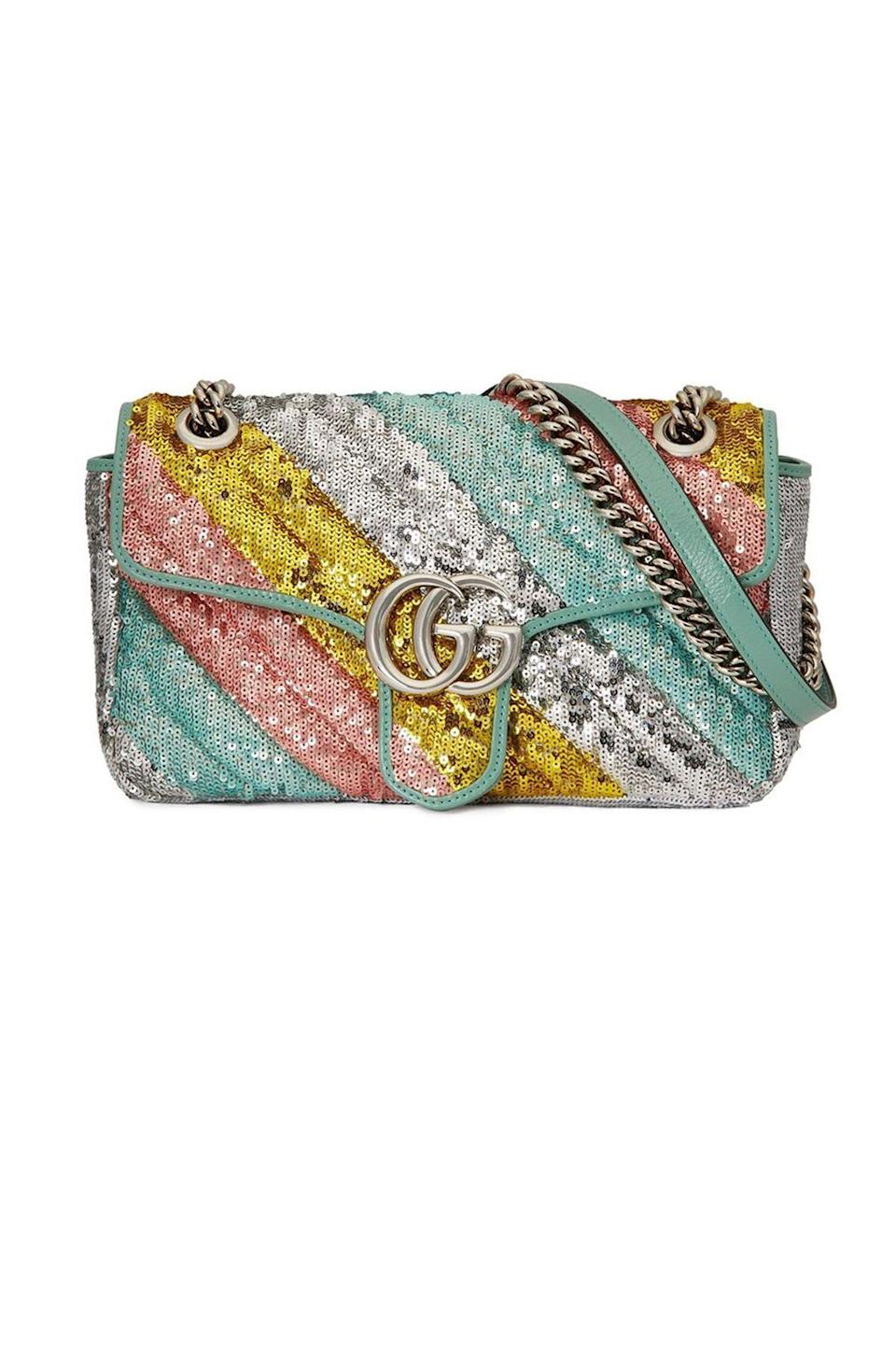 """<p><strong>Gucci</strong></p><p>farfetch.com</p><p><strong>$2980.00</strong></p><p><a href=""""https://go.redirectingat.com?id=74968X1596630&url=https%3A%2F%2Fwww.farfetch.com%2Fshopping%2Fwomen%2Fgucci-gg-marmont-sequinned-shoulder-bag-item-16079715.aspx&sref=https%3A%2F%2Fwww.townandcountrymag.com%2Fstyle%2Ffashion-trends%2Fg36544376%2Fbest-metallic-accessories%2F"""" rel=""""nofollow noopener"""" target=""""_blank"""" data-ylk=""""slk:Shop Now"""" class=""""link rapid-noclick-resp"""">Shop Now</a></p><p>Sequins! Sparkle! Gucci! This shoulder bag has it all and will jazz up even a simple white t-shirt and jeans. </p>"""