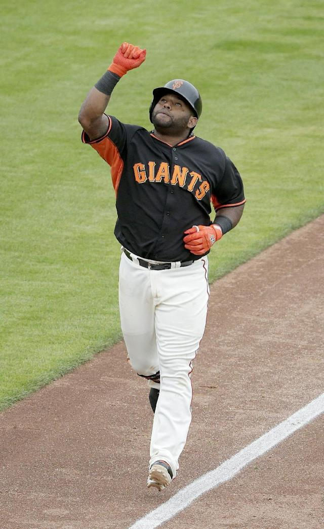 San Francisco Giants third baseman Pablo Sandoval celebrates a solo home run against the Cincinnati Reds during the fifth inning of a spring training baseball game in Scottsdale, Ariz., Thursday, March 6, 2014. (AP Photo/Chris Carlson)