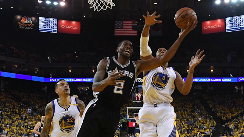 Warriors rally for 113-111 win after Spurs lose Leonard