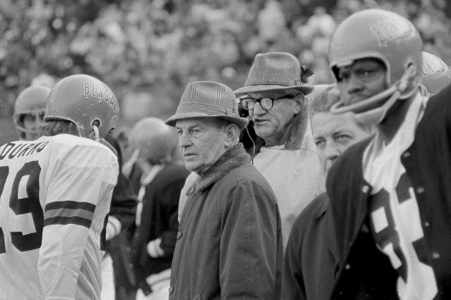 FILE - In this Nov. 7, 1971, file photo, Cincinnati Bengals coach Paul Brown, center, watches during the first quarter of an NFL football game against the Atlanta Falcons in Cincinnati, Ohio. The Cincinnati Bengals 14-10 victory over the Cleveland Browns on a snowy, November afternoon in 1970 put Browns new team on equal footing with his old one and made Ohio truly a two-team pro football state. (AP Photo/Gene Smith, File)