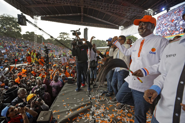 <p>Main opposition leader Raila Odinga, right, dances in front of his supporters at his final electoral campaign rally at Uhuru Park in Nairobi, Kenya, Saturday, Aug. 5, 2017. (Photo: Ben Curtis/AP) </p>