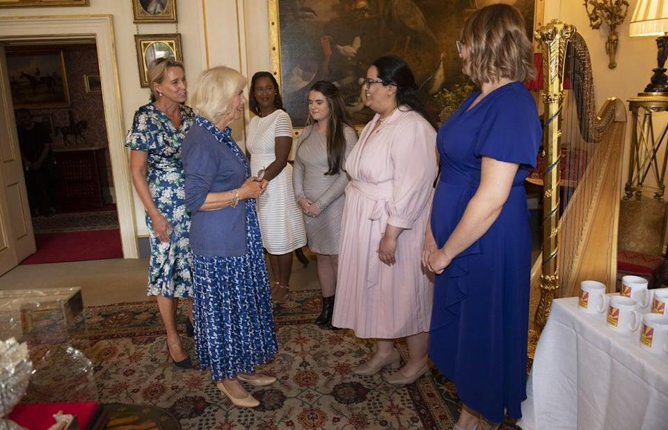 The Duchess of Cornwall meets with young women who have been supported by the Prince's Trust (Eddie Mulholland/Daily Telegraph) (PA Wire)