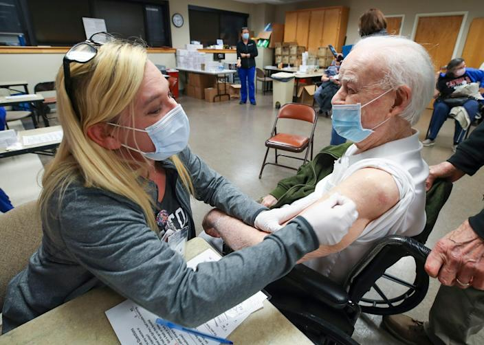 April Israel, RN, administers a shot to Don Robinson, 105, as he receives his second round of vaccinations for COVID-19 at Norton Audubon Hospital on Feb. 12, 2021.  Robinson was 3 years old when the Spanish Flu killed 675,000 people in the US.