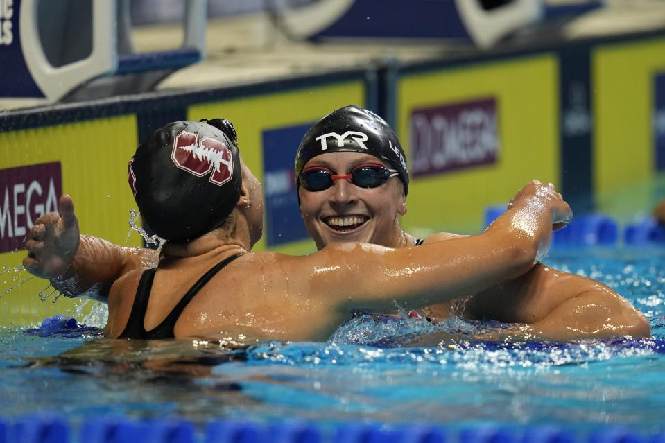Katie Ledecky gets a hug from Katie McLaughlin after winning in the women's 200 freestyle during wave 2 of the U.S. Olympic Swim Trials on Wednesday, June 16, 2021, in Omaha, Neb.(AP Photo/Jeff Roberson)