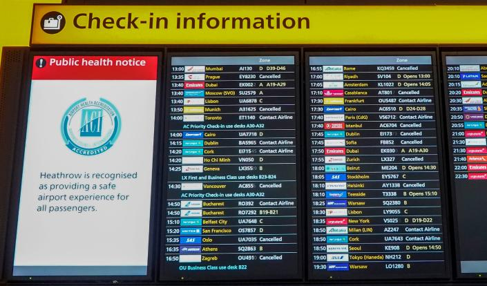 Travel is disrupted at Heathrow because of a new COVID-19 variant. (Photo by Niklas HALLE'N / AFP via Getty Images)