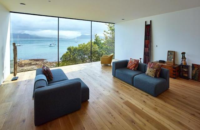 The huge window at the end of the main living space shows views across the water (Picture: Andrew Lee)