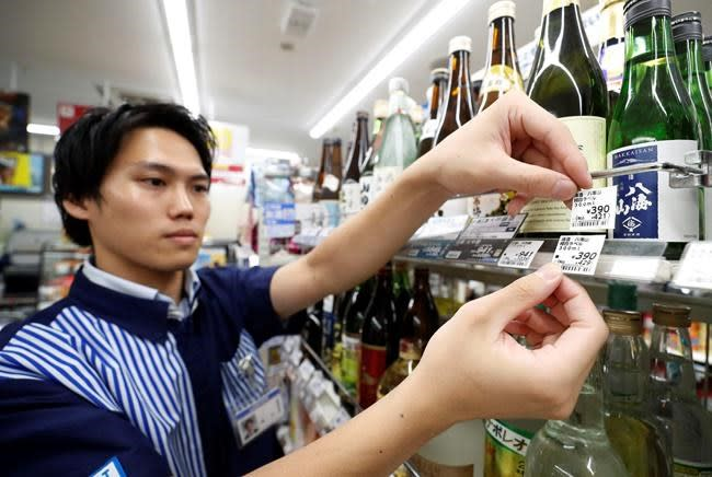 Japan ups sales tax to 10% amid signs economy is weakening