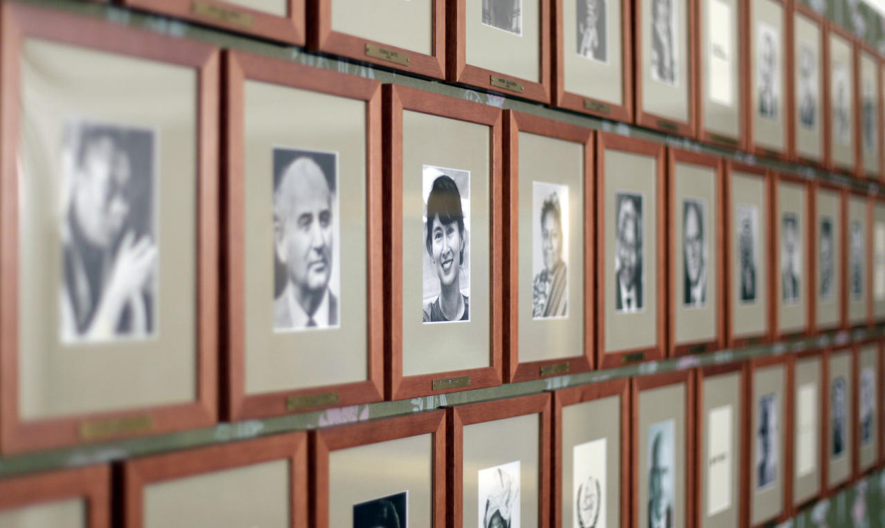 A portrait of Myanmar opposition leader Aung San Suu Kyi, center in focus, hangs alongside those of other Nobel Prize recipients in the Nobel Institute in Oslo June 16, 2012. Suu Kyi will give her Nobel Peace Prize acceptance speech. (AP Photo/Cathal McNaughton, Pool)