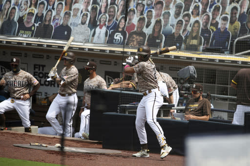 San Diego Padres Fernando Tatis Jr., warms up in the on-deck circle against the San Francisco Giants during the first inning of a baseball game Sunday, Sept. 13, 2020, in San Diego. (AP Photo/Derrick Tuskan)