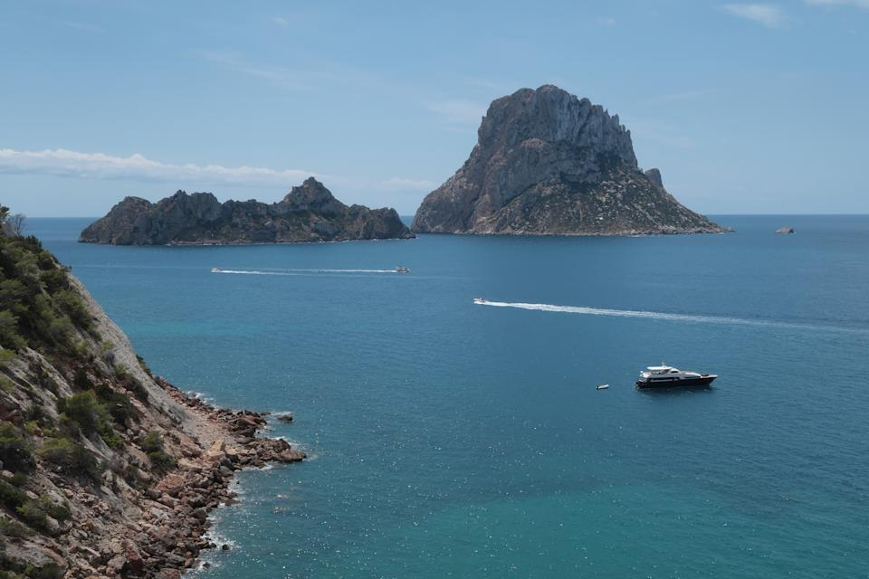IBIZA, SPAIN - AUGUST 11:  Es Vedra island (R) stands close to the island of Ibiza on August 11, 2017 near Sant Josep, Spain. Ibiza is a popular tourist destination.  (Photo by Sean Gallup/Getty Images)