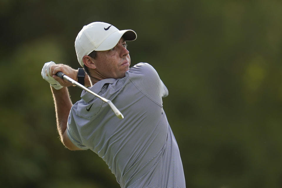 Rory McIlroy, of Northern Ireland, tees off on the 13th hole during the first round of the BMW Championship golf tournament, Thursday, Aug. 26, 2021, at Caves Valley Golf Club in Owings Mills, Md. (AP Photo/Julio Cortez)