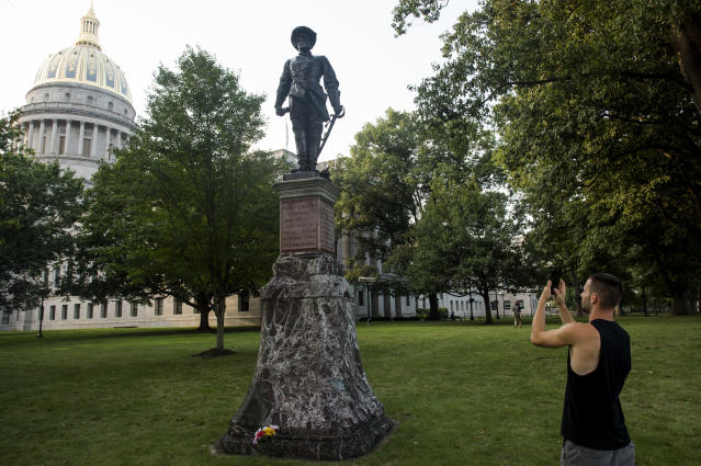 <p>A passerby stops to take a picture of the statue of Confederate General Thomas Stonewall Jackson at the West Virginia State Capitol Complex on August 16, 2017 in Charleston, W.V. (Photo: Ty Wright/Getty Images) </p>