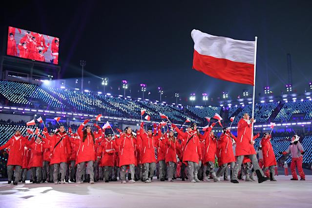 <p>Flag bearer Zbigniew Brodka of Poland and teammates arrive during the Opening Ceremony of the PyeongChang 2018 Winter Olympic Games at PyeongChang Olympic Stadium on February 9, 2018 in Pyeongchang-gun, South Korea. (Photo by Matthias Hangst/Getty Images) </p>