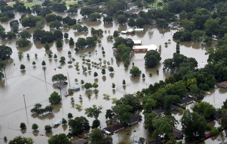 Anaerial image shows flooded areas of North Baton Rouge. (Photo: Patrick Dennis/The Advocate via AP)