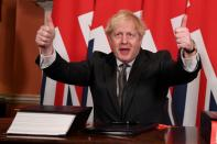 FILE PHOTO: Britain's Prime Minister Boris Johnson signs the Brexit trade deal with EU