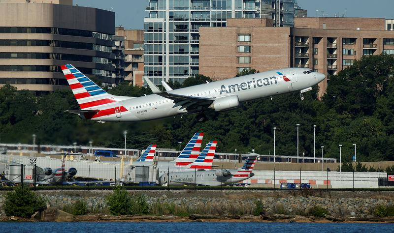 An American Airlines jet takes off from Washington National Airport in Washington