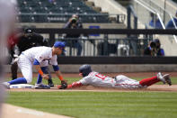 New York Mets third baseman J.D. Davis, left, tags out Washington Nationals' Victor Robles at third base during the third inning of a baseball game at Citi Field, Sunday, April 25, 2021, in New York. (AP Photo/Seth Wenig)