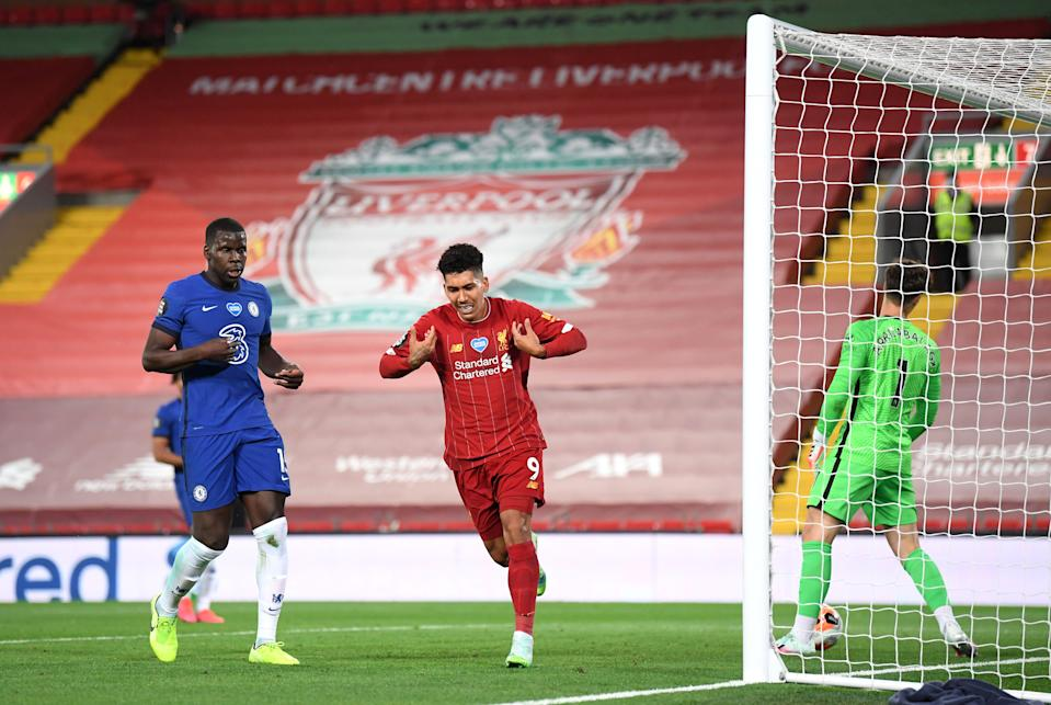 Liverpool striker Roberto Firmino scores his team's fourth goal during the Premier League match against Chelsea FC at Anfield. (PHOTO: Laurence Griffiths/Getty Images)
