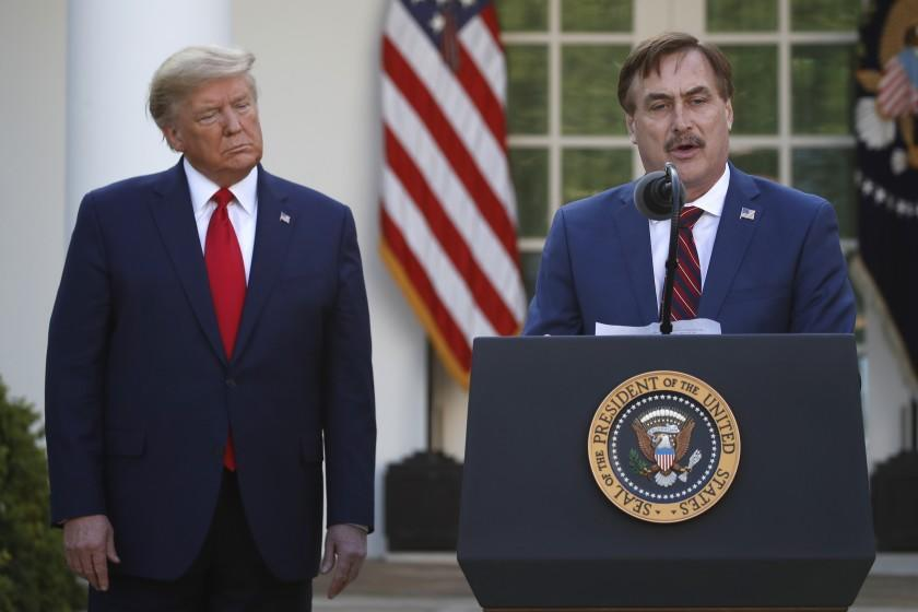 My Pillow CEO Mike Lindell speaks as President Donald Trump listens during a briefing about the coronavirus in the Rose Garden of the White House, Monday, March 30, 2020, in Washington. (AP Photo/Alex Brandon)