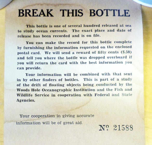 This January 2014 photo released by the Woods Hole Oceanographic Institution on Cape Cod, Massachusetts, shows a message found inside a glass bottle recovered on Sable Island, Nova Scotia, by biologist Warren N. Joyce of Canada's Department of Fisheries and Oceans. The bottle was among thousands dumped in the Atlantic Ocean between 1956 and 1972 as part of a program by Woods Hole oceanographer Dean Bumpus to study surface and bottom currents. About 10 percent of the 300,000 drift bottles have been found over the years. (AP Photo/Warren N. Joyce)