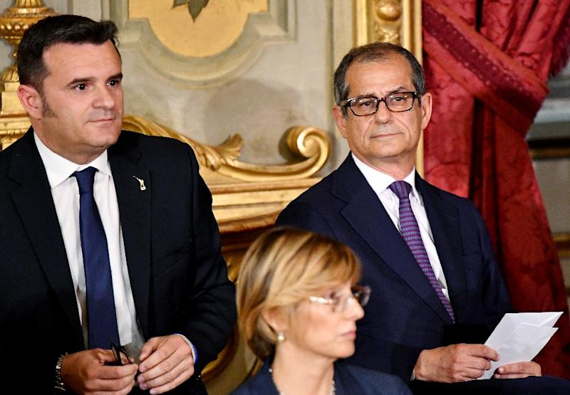 "Economy Minister Giovanni Tria (R) is under pressure to produce what Italy's anti-establishment leaders say would be a ""courageous"" budget"