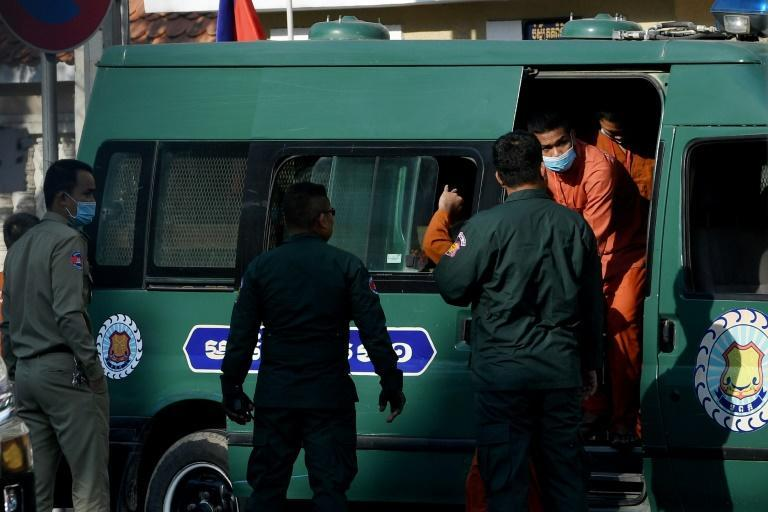 Members of the opposition and activists leave a prison van in front of the Phnom Penh court