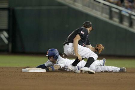 Jun 21, 2018; Omaha, NE, USA; Florida Gators shortstop Deacon Liput (8) slides safely into second against Texas Tech Red Raiders shortstop Michael Davis (3) in the seventh inning in the College World Series at TD Ameritrade Park. Mandatory Credit: Bruce Thorson-USA TODAY Sports