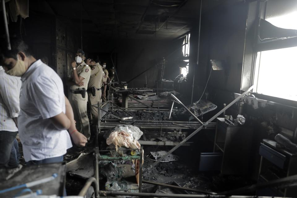 People inspect an ICU ward after a fire broke out in Vijay Vallabh COVID-19 hospital at Virar, near Mumbai, India, Friday, April 23, 2021. A fire killed 13 COVID-19 patients in a hospital in western India early Friday as an extreme surge in coronavirus infections leaves the nation short of medical care and oxygen. (AP Photo)