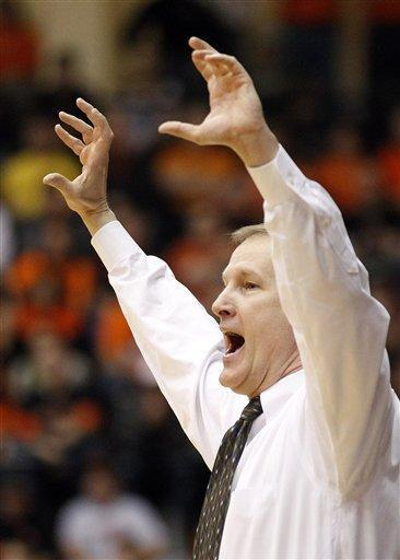 Oregon head coach Dana Altman shouts to his team in the first half of an NCAA college basketball game against Oregon State, Sunday, Feb. 26, 2012, in Corvallis, Ore. (AP Photo/Rick Bowmer)