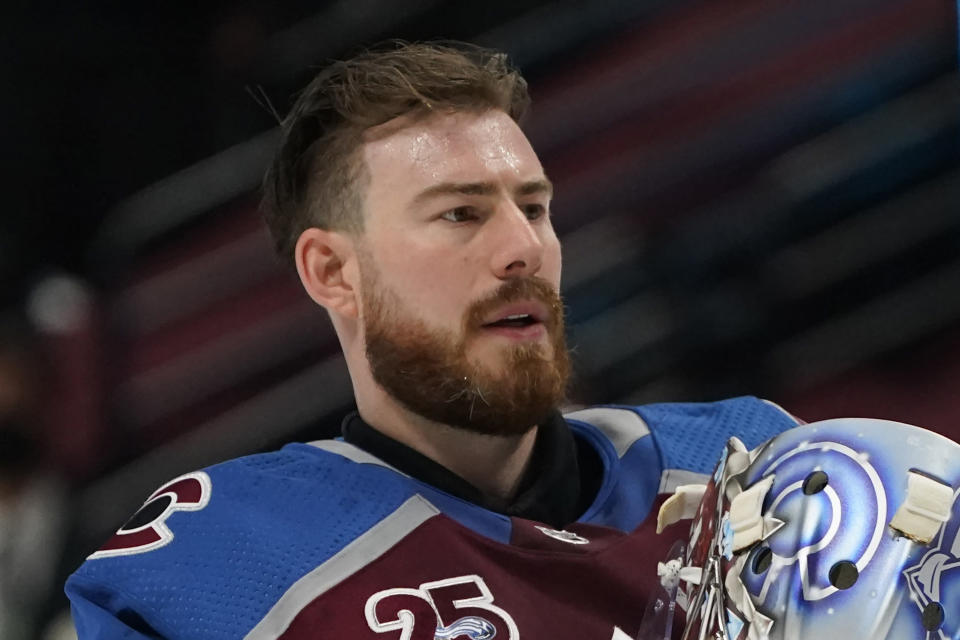 FILE - Colorado Avalanche goaltender Philipp Grubauer (31) is shown in the first period of an NHL hockey game against the San Jose Sharks in Denver, in this Friday, April 30, 2021, file photo. This was an unprecedented offseason of goaltender movement around the NHL. Vegas traded Vezina Trophy winner Marc-Andre Fleury to Chicago. Finalist Philipp Grubauer couldn't agree to a deal with Colorado and signed with expansion Seattle in free agency. And those moves set off a domino effect that included 25 different goalies changing teams. (AP Photo/David Zalubowski, File)