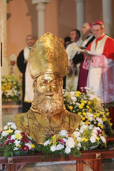"""A statue of Syriac Catholic Bishop Flavianus Michael Melki, martyred during the """"Assyrian Genocide,"""" is seen during his beatification at the Patriarchal convent of Our Lady of Deliverance in Harissa, Lebanon, north of Beirut on August 29, 2015 (AFP Photo/Ezzat Attar)"""