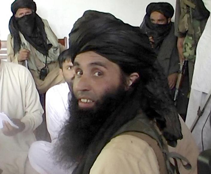 This frame grab taken November 11, 2013, from a 2008 video footage shows Maulana Fazlullah, newly appointed chief of Tehreek-e-Taliban Pakistan (TTP), speaking with local journalists in the Pakistan's northwestern Swat valley. (AFP via Getty Images)
