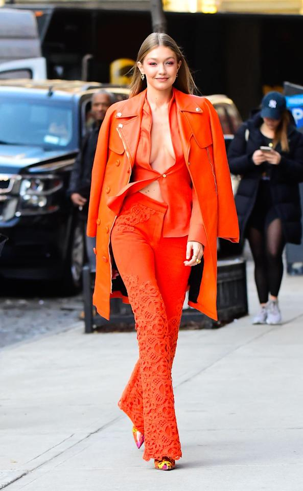 <p>Braving the cold, Gigi wore a monochromatic orange ensemble while heading out to visit the IMG Models offices in New York City. Despite the freezing temperatures, the star wore a shirt held together with only one button, which flapped in the wind. She draped a Philip Klein coat over her shoulders.<br></p>