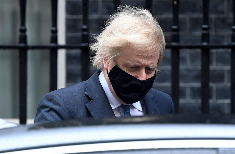 Britain's Prime Minister Boris Johnson, wearing a protective face covering to combat the spread of the coronavirus, leaves 10 Downing Street in central London on March 10, 2021, to take part in the weekly session of Prime Minister's Questions (PMQs) at the House of Commons. (Photo by - / AFP) (Photo by -/AFP via Getty Images)