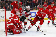 Detroit Red Wings goaltender Jimmy Howard (35) stops a shot by New Jersey Devils right wing Joey Anderson (49) during the third period of an NHL hockey game Friday, March 29, 2019, in Detroit. (AP Photo/Paul Sancya)